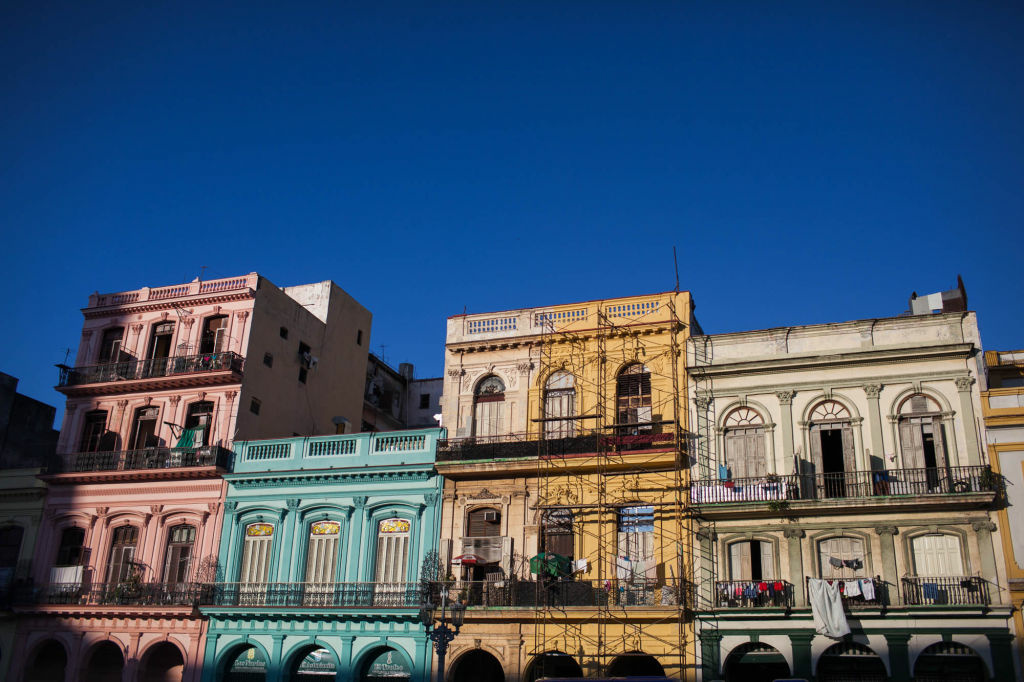 Colorful buildings line the Plaza de la Revolucion in Havana, Cuba.