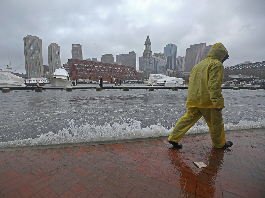 Flooding in Boston's North End during a nor'easter storm on March 2, 2018. A new government report suggests floods will become more common over the next century.