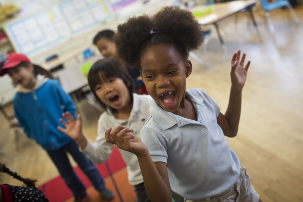 Kindergartener Kayla Ford dances and sings to a song in Mandarin at Eugene Field Elementary in Pasadena on Thursday morning, May 28, 2015. Children at the school are taught a mix of traditional and popular Chinese songs.