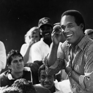 O. J. Simpson talks to Trojan football players about desire, dedication and talent. Photo dated: September 16, 1987.