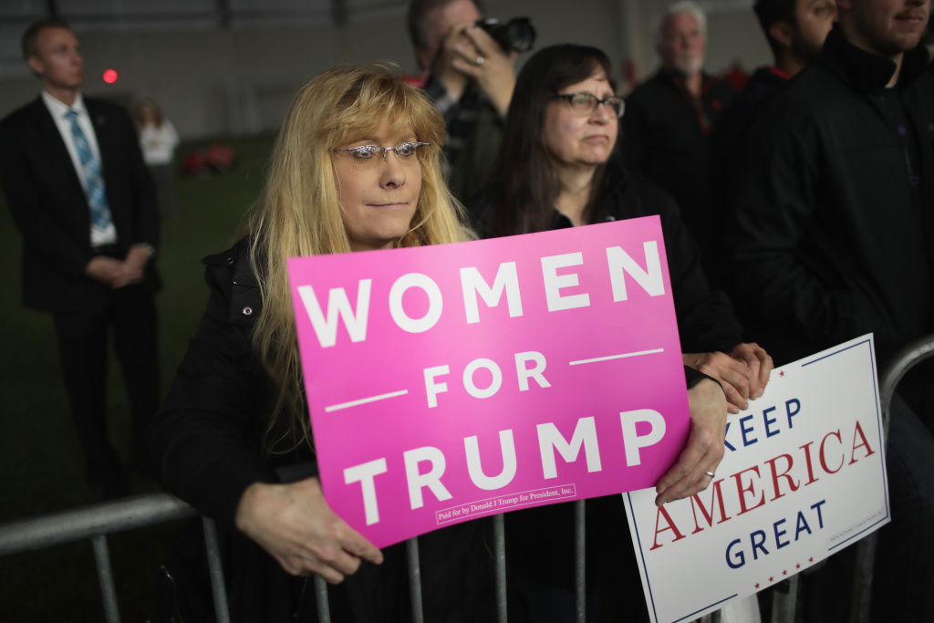 Supporters listen as President Donald Trump speaks at a campaign rally on April 28, 2018 in Washington Michigan. Trump opened his speech mentioning that he was skipping the White House Correspondents dinner in Washington, DC to be at the rally.