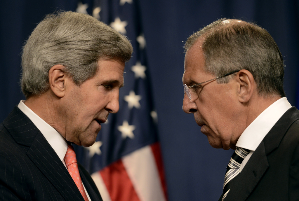 US Secretary of State John Kerry (L) speaks with Russian Foreign Minister Sergey Lavrov (R) before a press conference in Geneva on September 14, 2013 after they met for talks on Syria's chemical weapons. Washington and Moscow have agreed a deal to eliminate Syria's chemical weapons, Kerry said after talks with Lavrov.