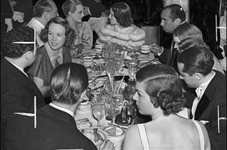 Dinner Party Download hosts Rico Gagliano (upper right) and Brendan Newnam (lower left, back to camera) fete Norma Shearer at a dinner party at the Biltmore in 1936.