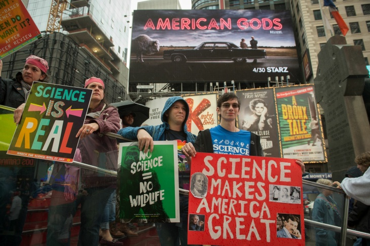 Michael Sawaya, a biologist at UCLA, is joined by his brother and mother at the March for Science in Los Angeles on April 22, 2017.