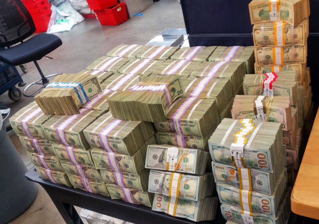 This Aug. 26, 2016 photo provided by the U.S. Border Patrol shows some of more than $3 million in cash that two men were trying to smuggle into Mexico from California.