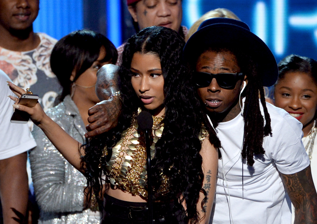 Singer Nicki Minaj (L) and rapper Lil Wayne of Young Money accepting a BET award in 2014 (Photo by Kevin Winter/Getty Images for BET)
