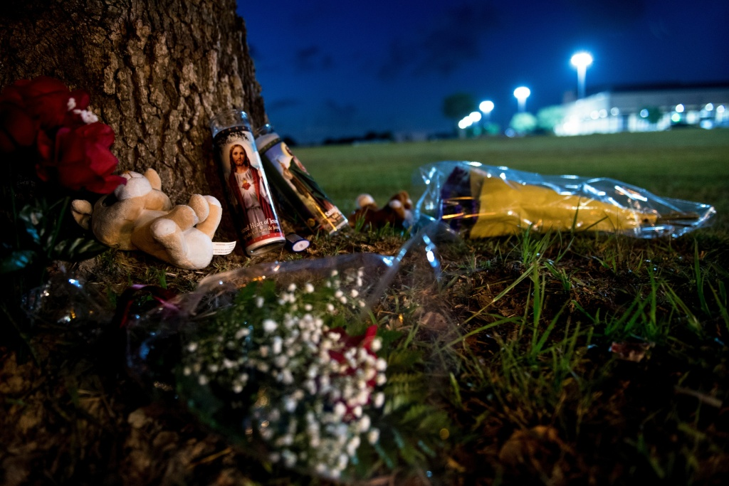 A makeshift memorial is seen outside Santa Fe High School a day after a mass shooting May 19, 2018 in Santa Fe, Texas.