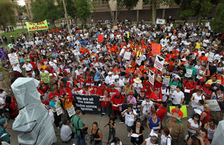 Protesters from California join Arizonans at the state capitol building for a demonstration against Arizona's immigration enforcement law SB 1070 on July 29, 2010 in Phoenix, Ariz.