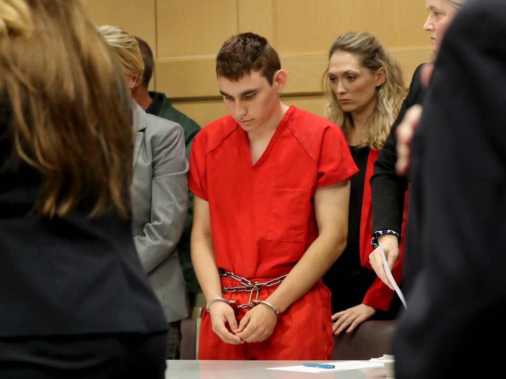 Alleged shooter Nikolas Cruz appears in court for a status hearing before Broward Circuit Judge Elizabeth Scherer earlier this month. He is facing 17 charges of premeditated murder in the mass shooting at Marjory Stoneman Douglas High School in Parkland, Fla.