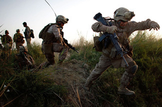 Lance Cpl. Chris Garcia and other members of Golf Company cross an irrigation ditch as the 2nd Battalion, 8th Marine Regiment moves into Helmand province in July during a major offensive against the Taliban stronghold in southern Afghanistan.