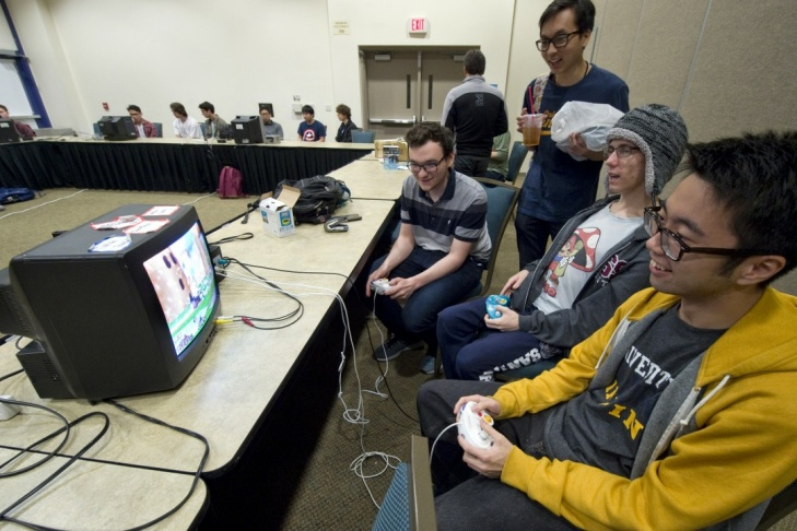 (From left) Griffin Williams, Benjamin Tolan and Jason Chen play Super Smash Bros. at the UCI Student Center.