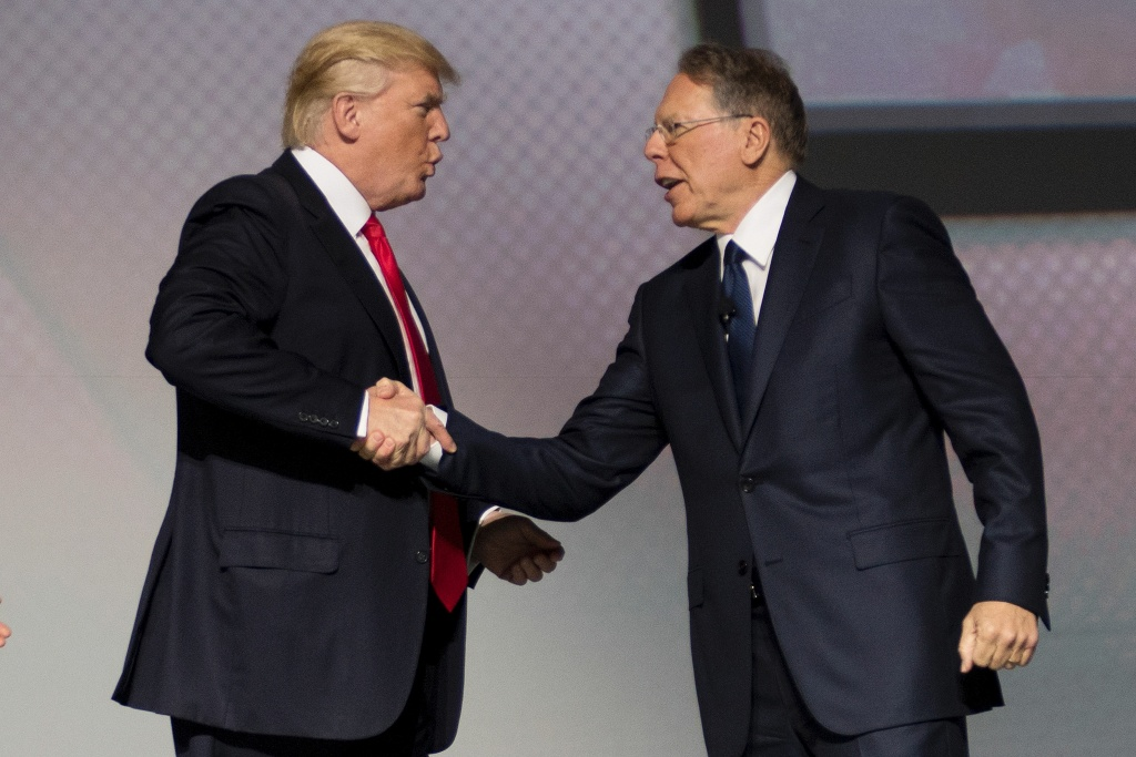 U.S. President Donald Trump shakes hands with National Rifle Association (NRA) President Wayne LaPierre during the NRA Leadership Forum in Atlanta, Georgia on April 28, 2017.