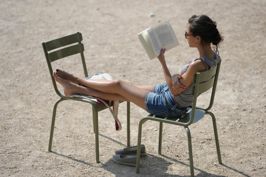 A women reads a book under the sun, which apparently is not the norm for Los Angeles. The city failed to make the shortlist for Amazon.com's
