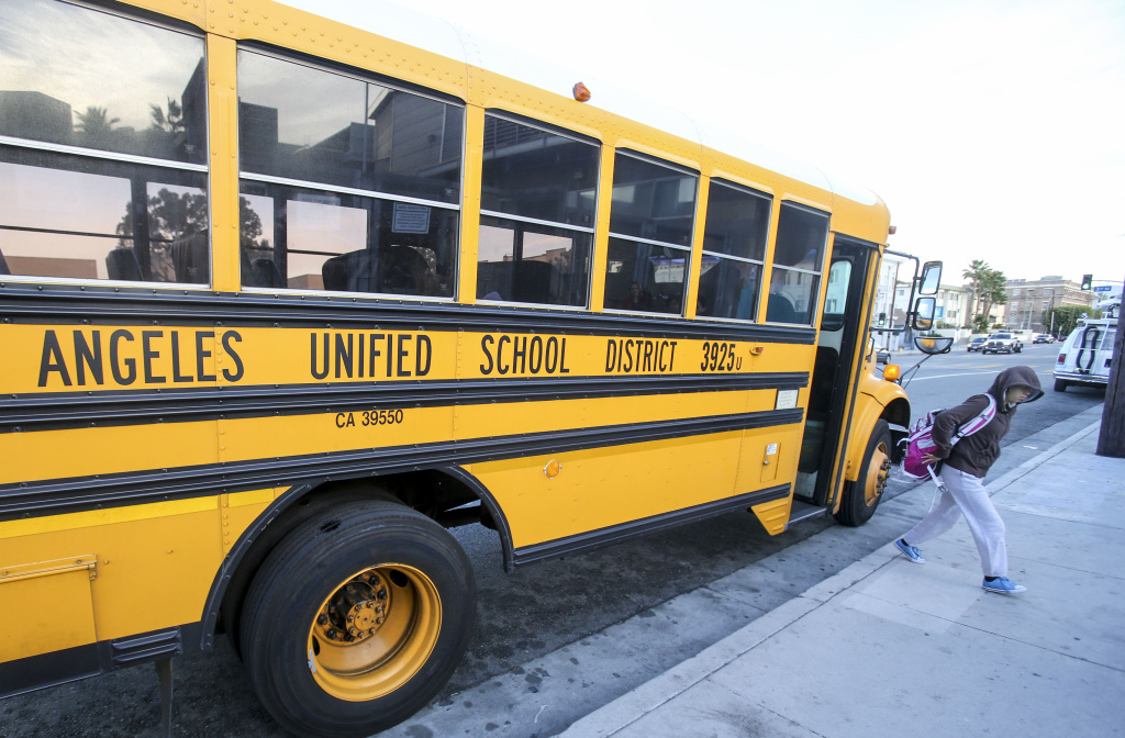 Students arrive at a school in Los Angeles on December 16, 2015.