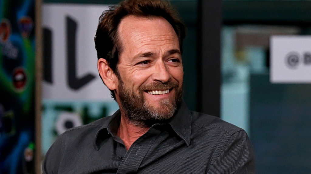 Luke Perry, seen here last October during a press appearance for the TV series <em>Riverdale</em>, has died following a massive stroke, his publicist said Monday.