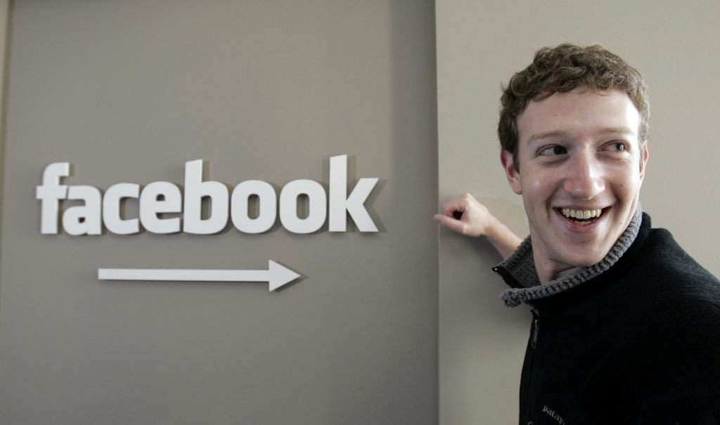 In this Feb. 5, 2007 file photo, Facebook CEO Mark Zuckerberg smiles in this office in Palo Alto, Calif.