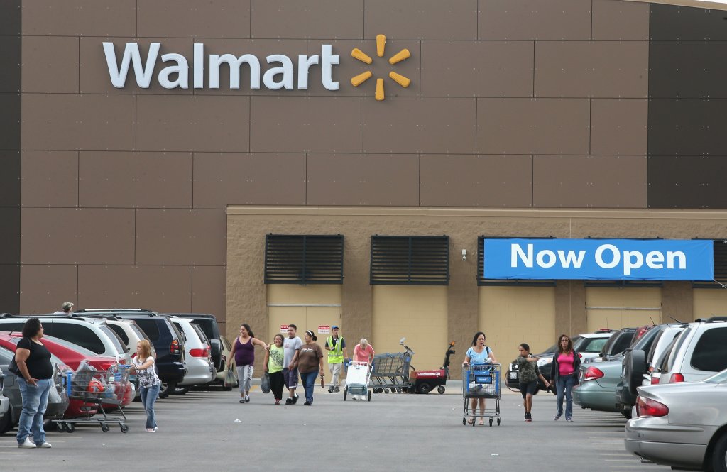 Customers shop at a Walmart store on August 15, 2013 in Chicago, Illinois.