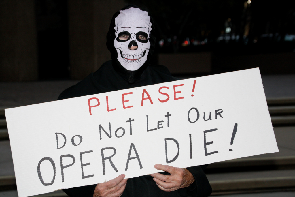 San Diego Opera senior docent Kathleen Kay O'Neil, protesting the decision to close the opera company.