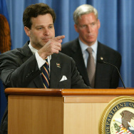 Assistant U.S. Attorney General Christopher Wray (L), Marc Everson, IRS Commissioner and Alice Martin, U.S. Attorney for the Northern District of Alabama speak at the Justice Department on November 4, 2003 in Washington DC.