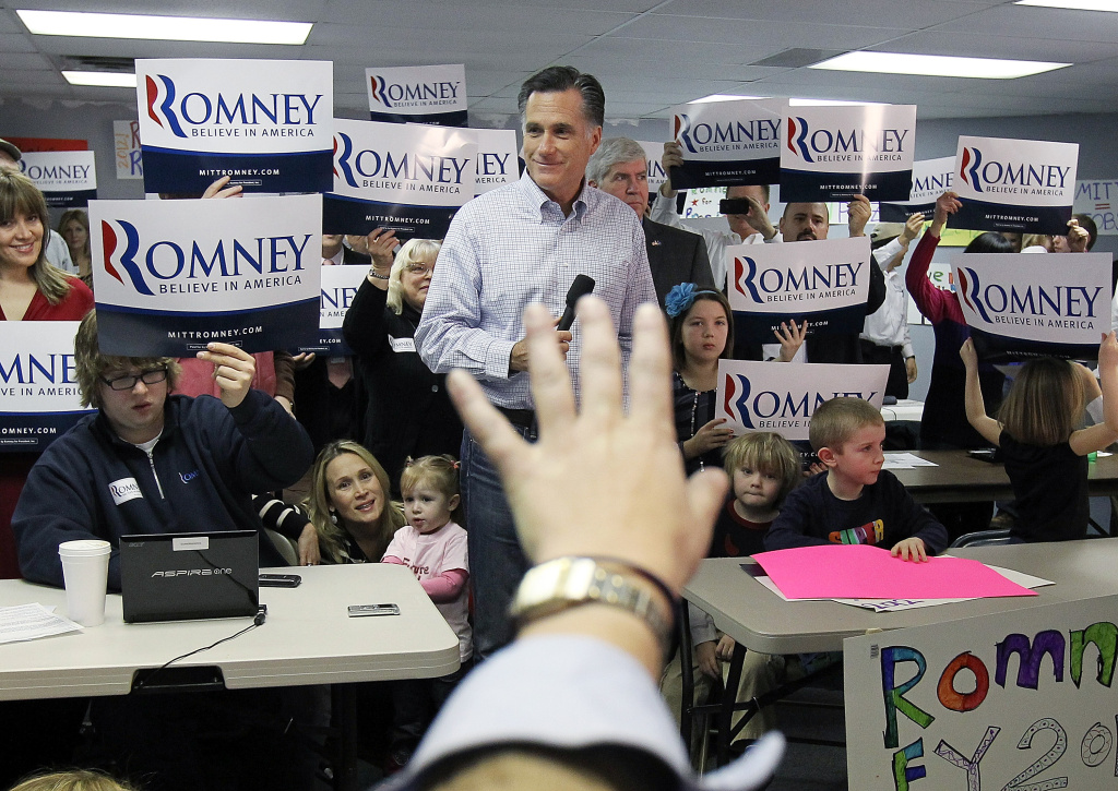 Republican presidential candidate and former Massachussetts Gov. Mitt Romney looks on during a press availability following a visit to his Michigan campaign headquarters
