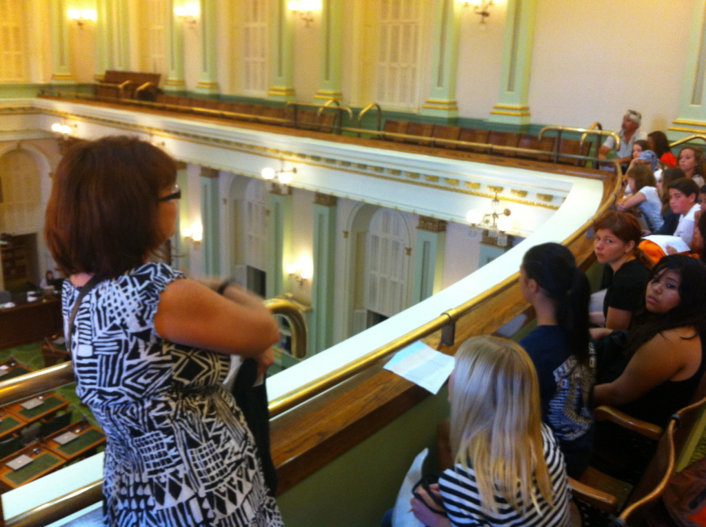 Middle school teacher Melanie Hill takes 8th graders on a tour of the capitol