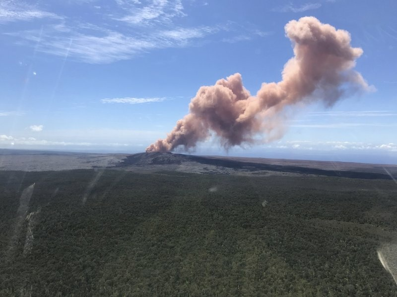 In this photo provided by the U.S. Geological Survey, red ash rises from the Puu Oo vent on Hawaii's Kilauea Volcano after a magnitude 5.0 earthquake struck the Big Island, Thursday, May 3, 2018 in Hawaii Volcanoes National Park.