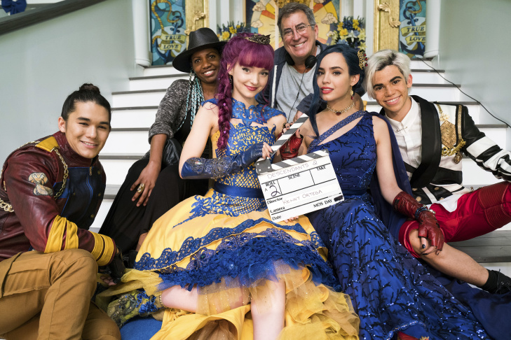 China Anne McClain (L), director Kenny Ortega, and Dove Cameron (R) on the set of