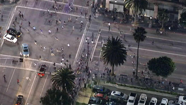 Police dispersed a crowd of several hundred who had gathered to see a film at the Vine Theater in Hollywood, after some began throwing items at passing cars and police on Saturday, October 13, 2012.
