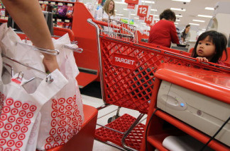 A young girl watches as a cashiers bags groceries at a Target store. U.S. consumer prices were flat last month, the latest sign inflation is in check. Low inflation leaves consumers with more money to spend, which benefits the economy. The consumer price index has risen 1.6 percent in the 12 months ending in January, the Labor Department said Thursday. That's down from a 2.9 percent pace a year ago.Excluding the volatile food and energy categories, core prices rose 0.3 percent in January, pushed up by higher costs for apparel, air fares and rents.