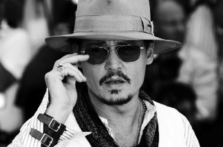 Johnny Depp poses during the photocall of Pirates of the Caribbean: On Stranger Tides.