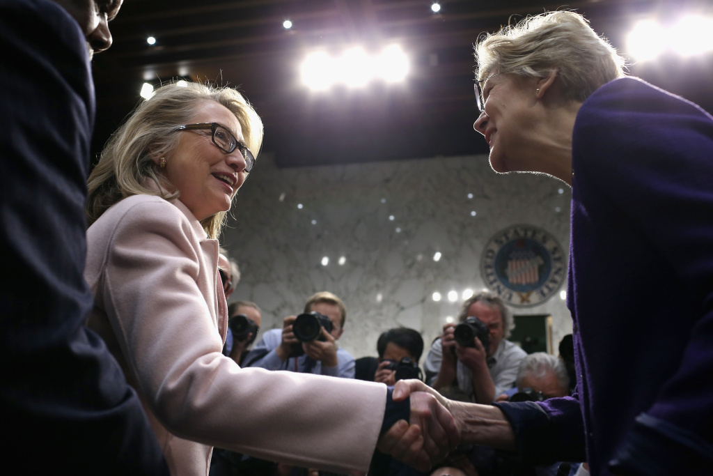 U.S. Secretary of State Hillary Clinton (L) greets Sen. Elizabeth Warren (D-MA) as they arrive for Sen. John Kerry's (D-MA) confirmation hearing before the Senate Foreign Relations Committee to become the next Secretary of State in the Hart Senate Office Building on Capitol Hill January 24, 2013 in Washington, DC.
