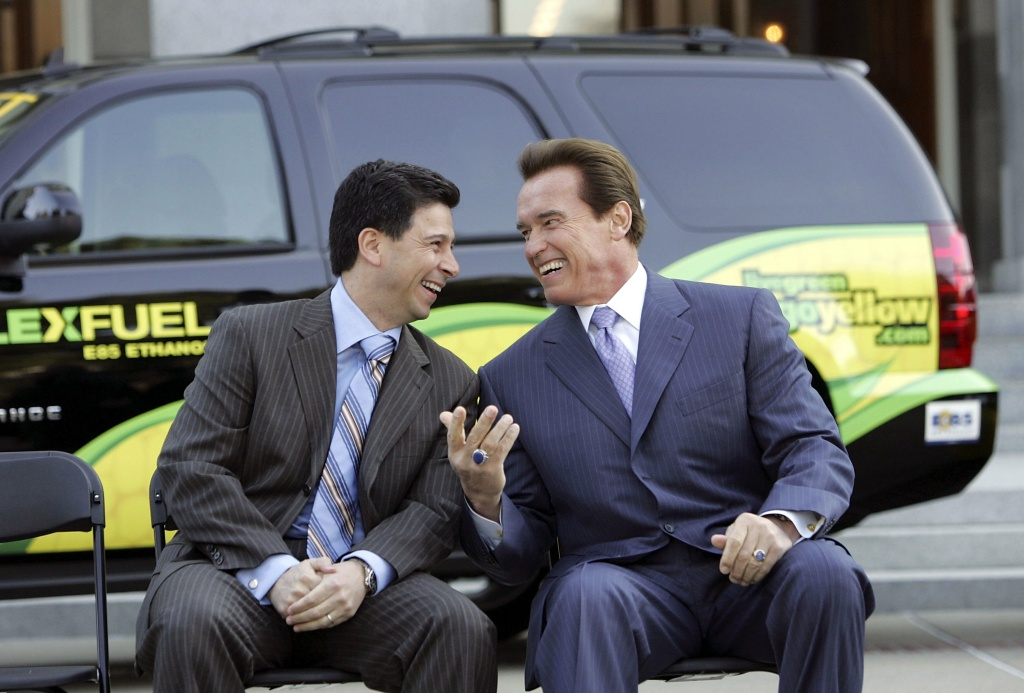 File: Then-California Gov. Arnold Schwarzenegger (R) laughs with California speaker of the Assembly Fabian Nunez before signing Executive Order S-01-07 during a ceremony at the California State Capitol on Jan. 18, 2007 in Sacramento.