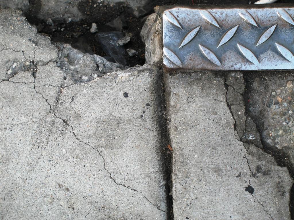 Damaged sidewalk in downtown Los Angeles