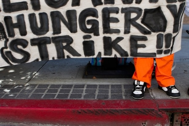 A banner at a protest in Downtown Los Angeles on Monday morning.