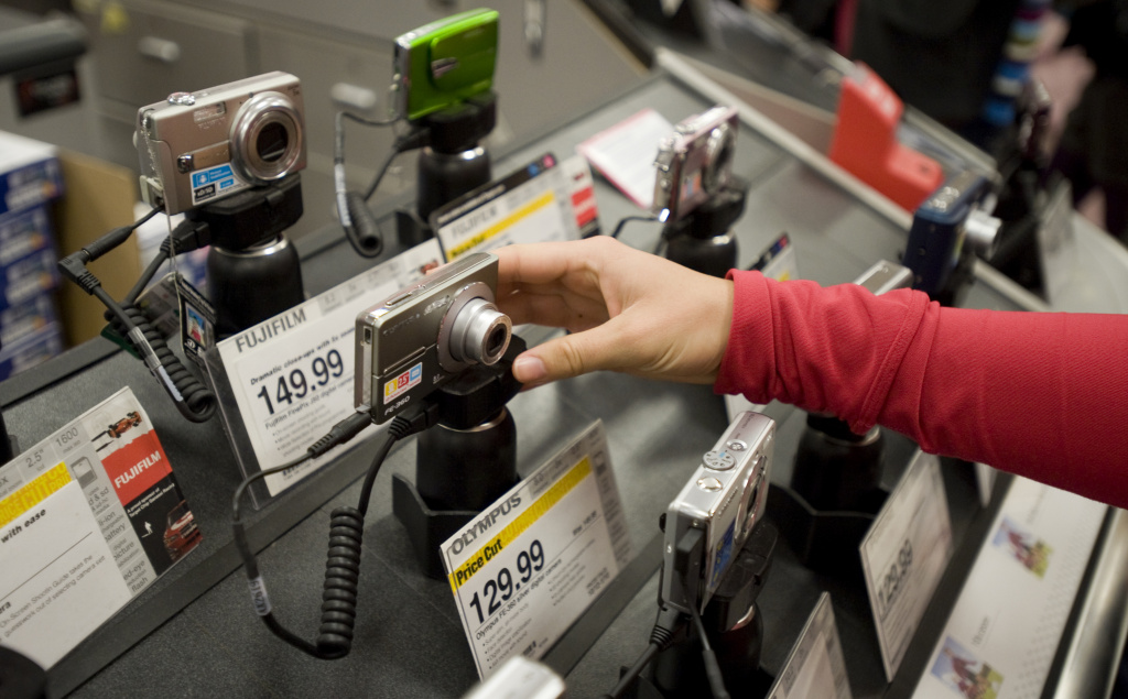 A shopper examines a point-and-shoot camera while shopping for electronics at a Target store in West Hollywood, California, on Nov. 28, 2008.