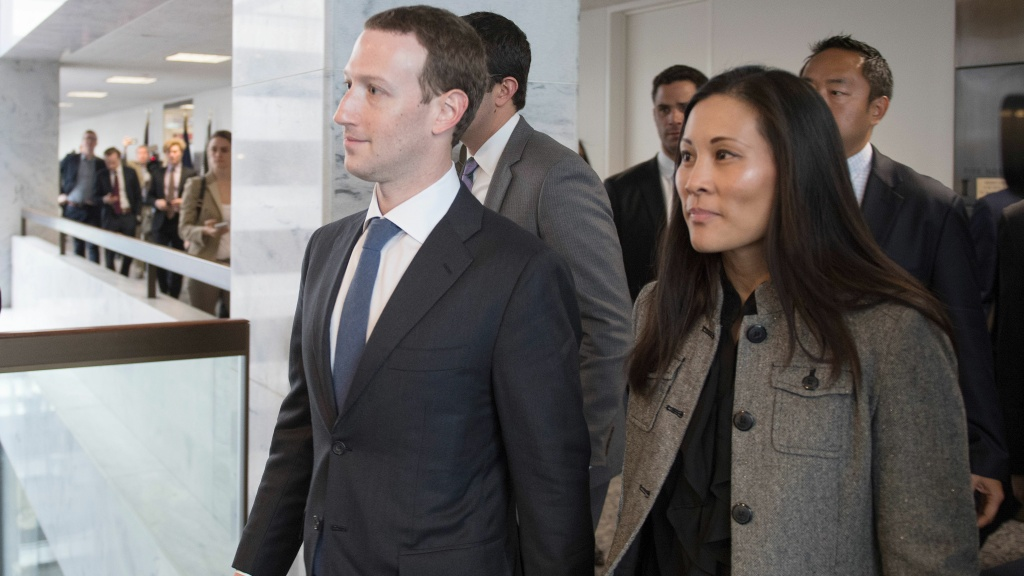 Facebook CEO Mark Zuckerberg and his wife, physician and philanthropist Priscilla Chan (right), depart the office of Sen. Bill Nelson, D-Fla., in Washington, D.C., on Monday.