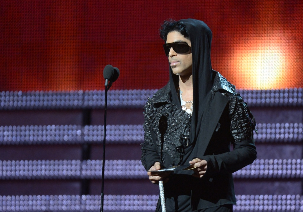 Prince presents the winner for Record of the Year to Gotye and Kimbra on stage at the Staples Center during the 55th Grammy Awards in Los Angeles, Feb. 10, 2013.