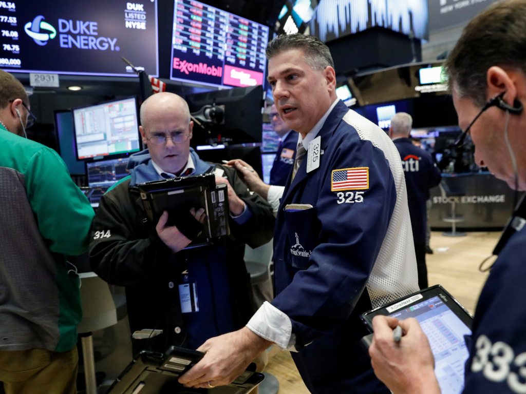 The floor of the New York stock exchange Thursday. The Dow Jones industrial average tumbled after the Trump administration announced plans to impose tariffs on Chinese imports.