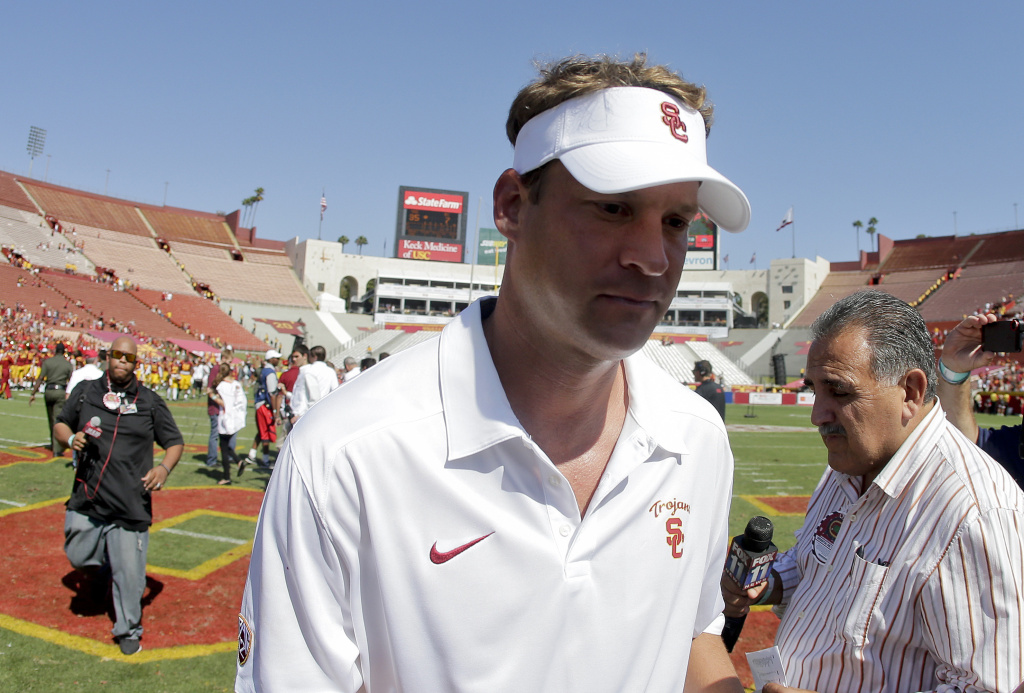 Southern California coach Lane Kiffin leaves the field after the game against Boston College during an NCAA college football game in Los Angeles, Saturday, Sept. 14, 2013.