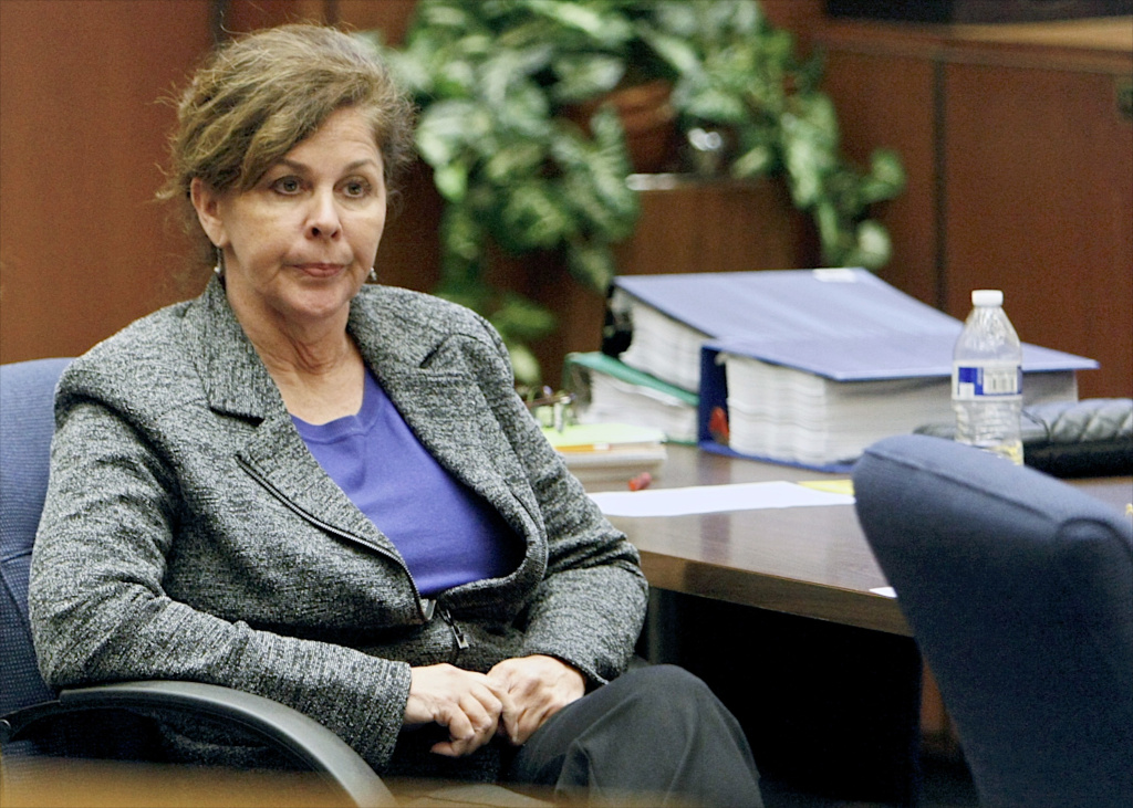 Former assistant city manager of Bell, Calif., Angela Spaccia who is charged with misappropriation of public funds and other counts, listens to opening statements in Los Angeles Superior Court, Wednesday, Oct. 23, 2013. Jurors were still deliberating on Tuesday on 13 counts against her.