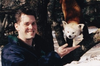 Jason Jacobs poses with a red panda at the Potawatomi Zoo in South Bend, Ind., in 2005. This was his first full-time zoo job. He started as education curator and became development director.