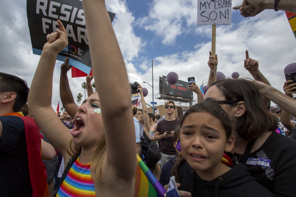 LOS ANGELES, CA - JUNE 11: Marchers react to hateful speech from provocative street preachers at the #ResistMarch during the 47th annual LA Pride Festival on June 11, 2017 in the Hollywood section of Los Angeles and West Hollywood, California. Inspired by the huge women's marches that took place around the world following the inauguration of President Donald Trump and by the early pride demonstrations of the 1970s, LA Pride replaced its decades-old parade with the #ResistMarch protest to promote human rights by marching from Hollywood to West Hollywood.  (Photo by David McNew/Getty Images)