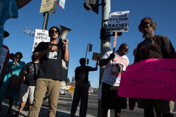 Mayor Eric Garcetti called for peaceful protests against the Trayvon Martin verdict Tuesday afternoon. He was joined by LAPD Charlie Beck (far left), City Attorney Mike Feuer, and County Supervisor Mark Ridley-Thomas (far right).