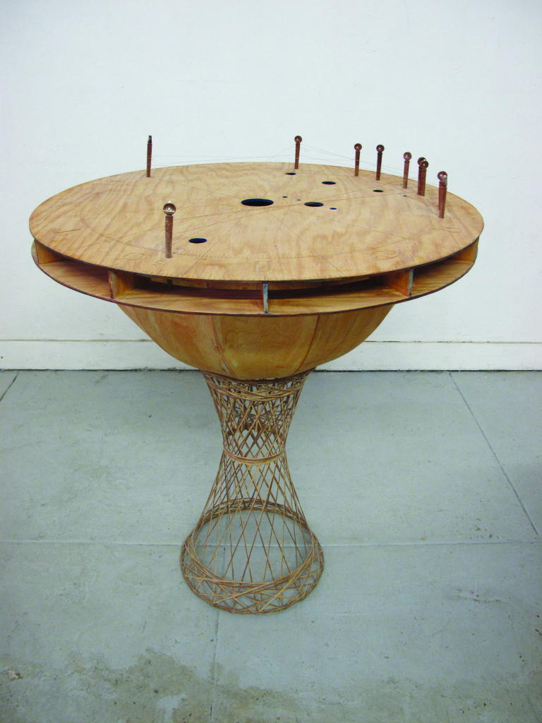Earth instrument from Katie Grinnan's Astrology Orchestra. Made of wood, sitar strings, pegs and fiber glass.