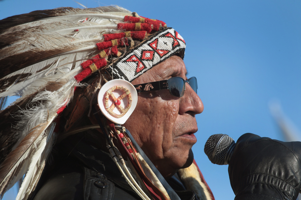 Chief Arvol Looking Horse of the Lakota/Dakota/Nakota Nation speaks during an interfaith ceremony at Oceti Sakowin Camp on the edge of the Standing Rock Sioux Reservation on December 4, 2016 outside Cannon Ball, North Dakota. Native Americans from around the country gathered at the camp for several months trying to halt the construction of the Dakota Access Pipeline.