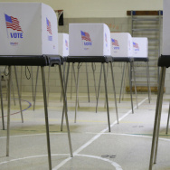 A woman casts her vote at a polling place inside Winfield Elementary School's gym in Windsor Mill, Md., on Tuesday.