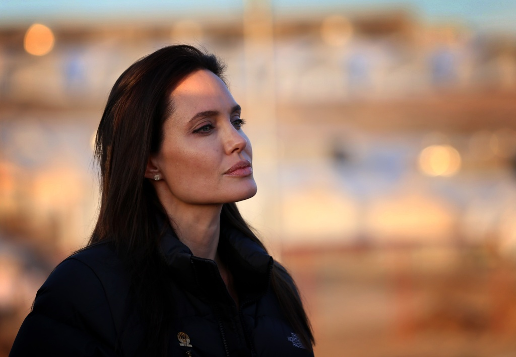 US actress and UNHCR ambassador Angelina Jolie stands during a visit to a camp for displaced Iraqis in Khanke, a few kilometres (miles) from the Turkish border in Iraq's Dohuk province, on January 25, 2015.