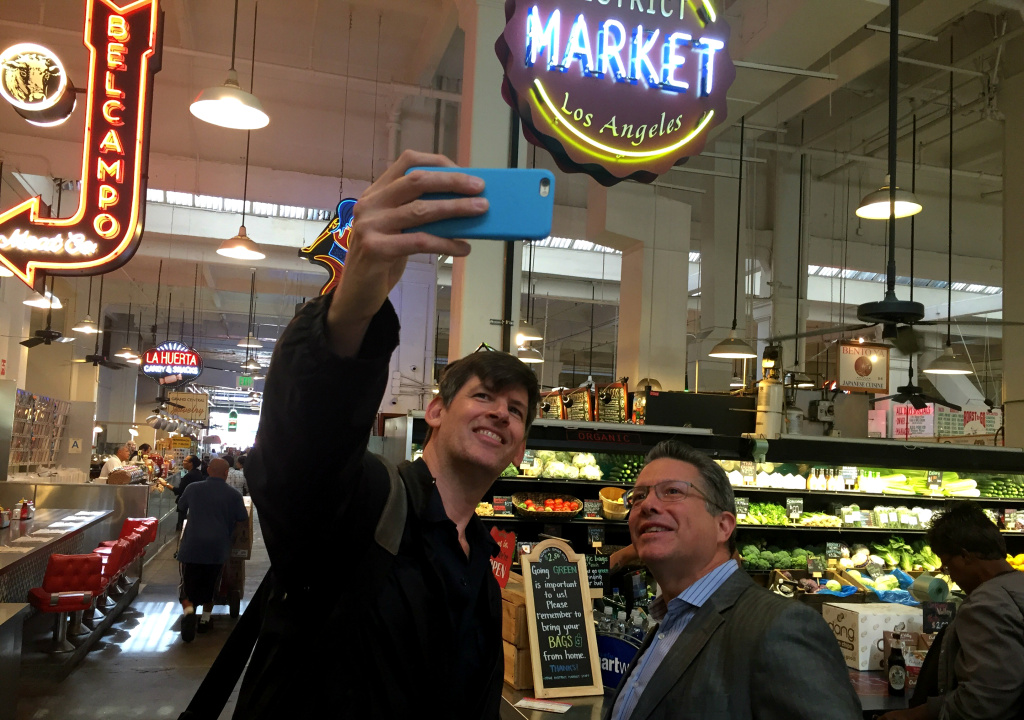 KPCC's John Rabe and reporter Jesse Katz inside LA's Grand Central Market. Jesse's article in the October issue of Los Angeles Magazine covers the market's huge debt, as well as a major discrimination lawsuit.