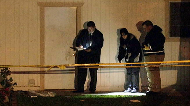 Detectives investigating a shooting by Santa Ana police search for evidence early Friday morning.