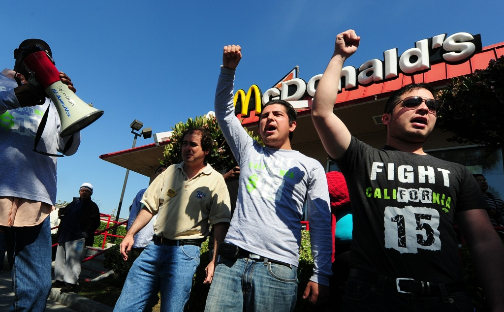 Protesters in front of a McDonald's in South L.A. where fast-food workers and their supporters gathered to protest wage theft in April 2014. Many fast-food restaurants like McDonald's say they have no control over hiring and firing decisions in franchises. That has made it difficult for unions to organize workers across a restaurant chain.